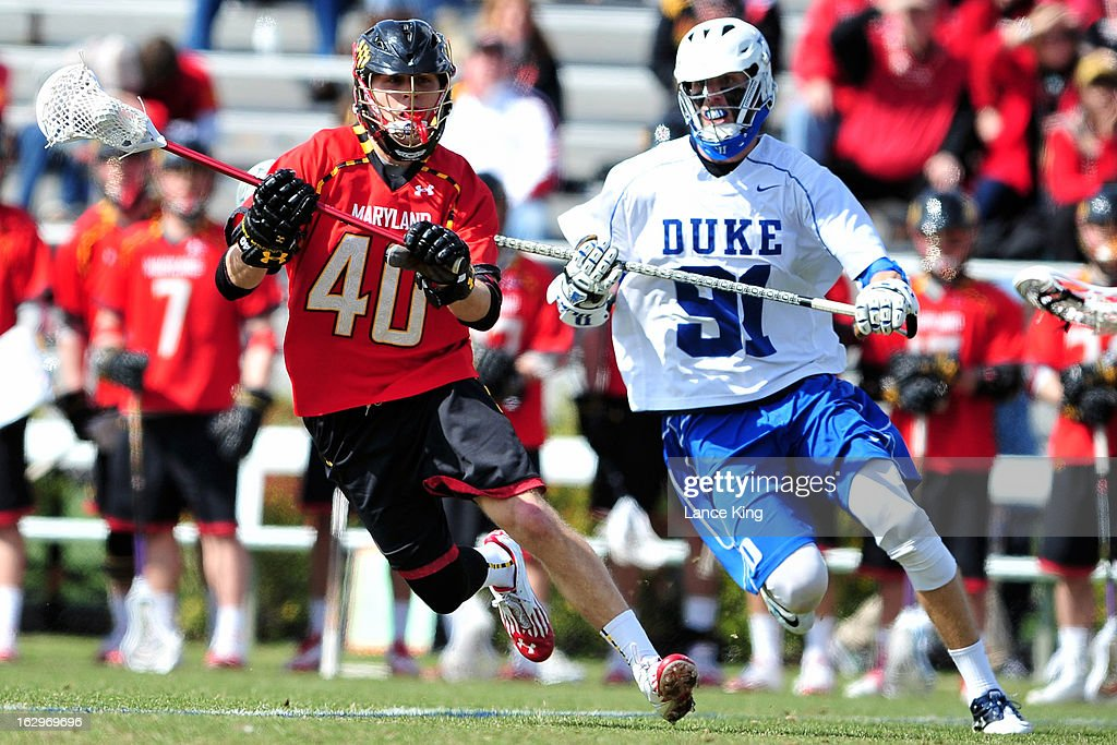 <a gi-track='captionPersonalityLinkClicked' href=/galleries/search?phrase=Brian+Cooper&family=editorial&specificpeople=234855 ng-click='$event.stopPropagation()'>Brian Cooper</a> #40 of the Maryland Terrapins runs with the ball against Luke Duprey #91 of the Duke Blue Devils at Koskinen Stadium on March 2, 2013 in Durham, North Carolina. Maryland defeated Duke 16-7.