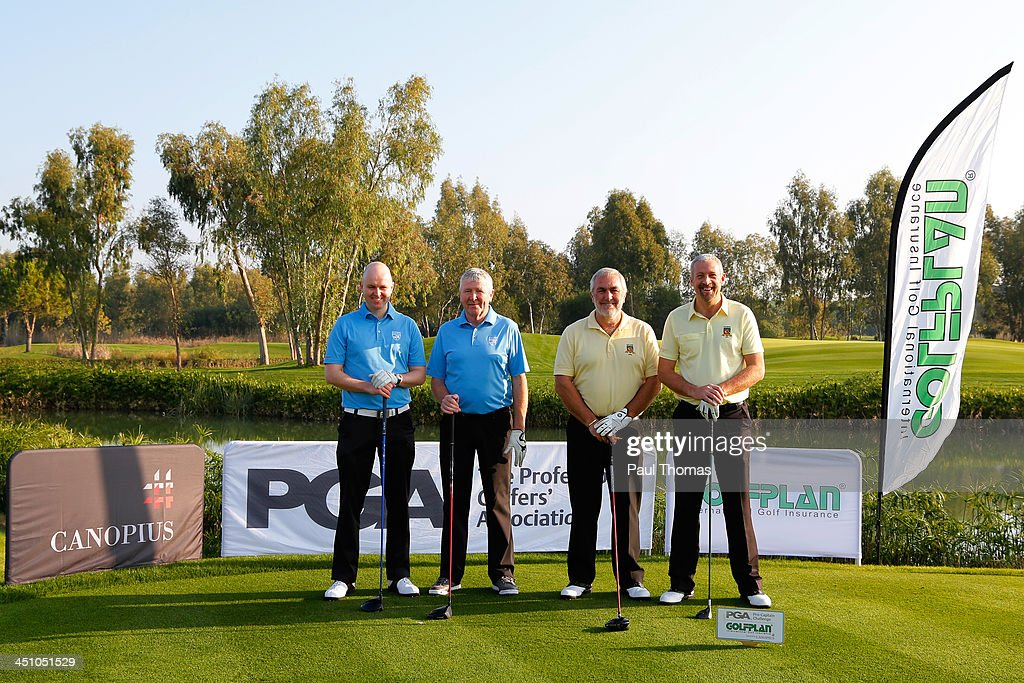 Brian Cosgrove (L) and Art O'Molloy of Killeen Golf Club along with Rob Edwards (R) and Michael Izzard of Lee-on-the-Solent Golf Club pose for a photograph on the PGA Sultan Course during day one of The Golfplan Insurance Pro Captain Challenge final at Antalya Golf Club on November 21, 2013 in Antalya, Turkey.