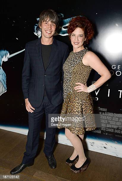 Brian Cox and Gia Milinovich attends a screening of 'Gravity' hosted by Professor Brian Cox at The Mayfair Hotel on November 6 2013 in London England