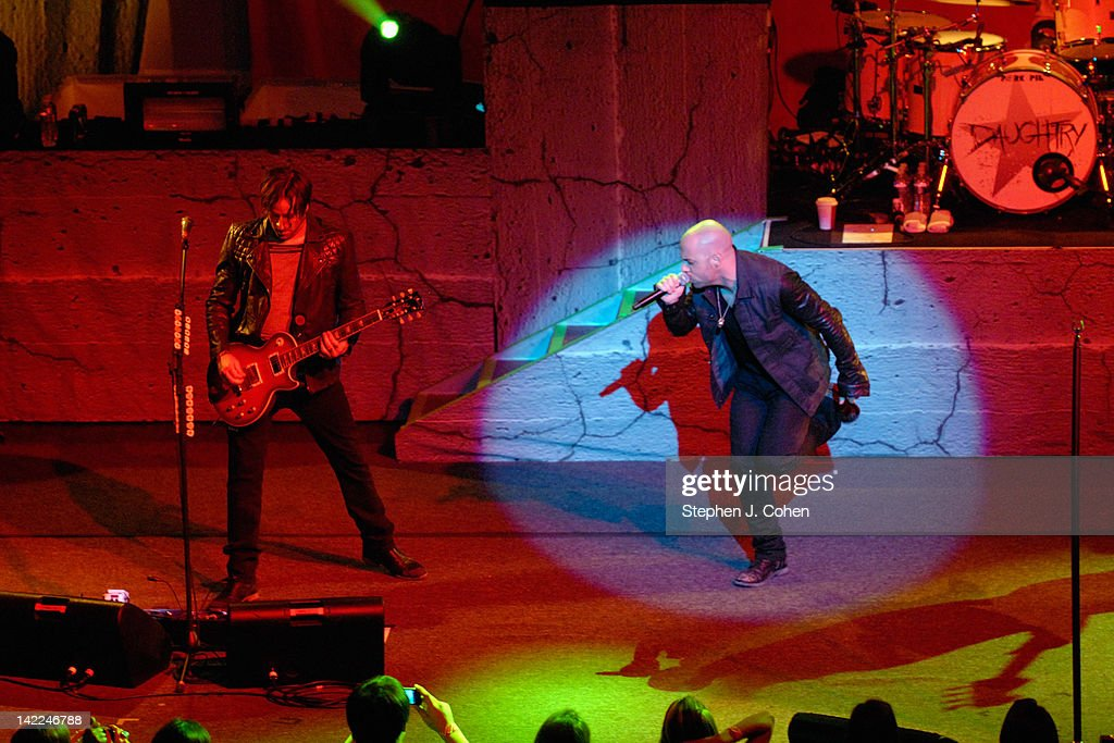 Brian Craddock and <a gi-track='captionPersonalityLinkClicked' href=/galleries/search?phrase=Chris+Daughtry&family=editorial&specificpeople=614842 ng-click='$event.stopPropagation()'>Chris Daughtry</a> of Daughtry performs at the Louisville Palace on March 31, 2012 in Louisville, Kentucky.