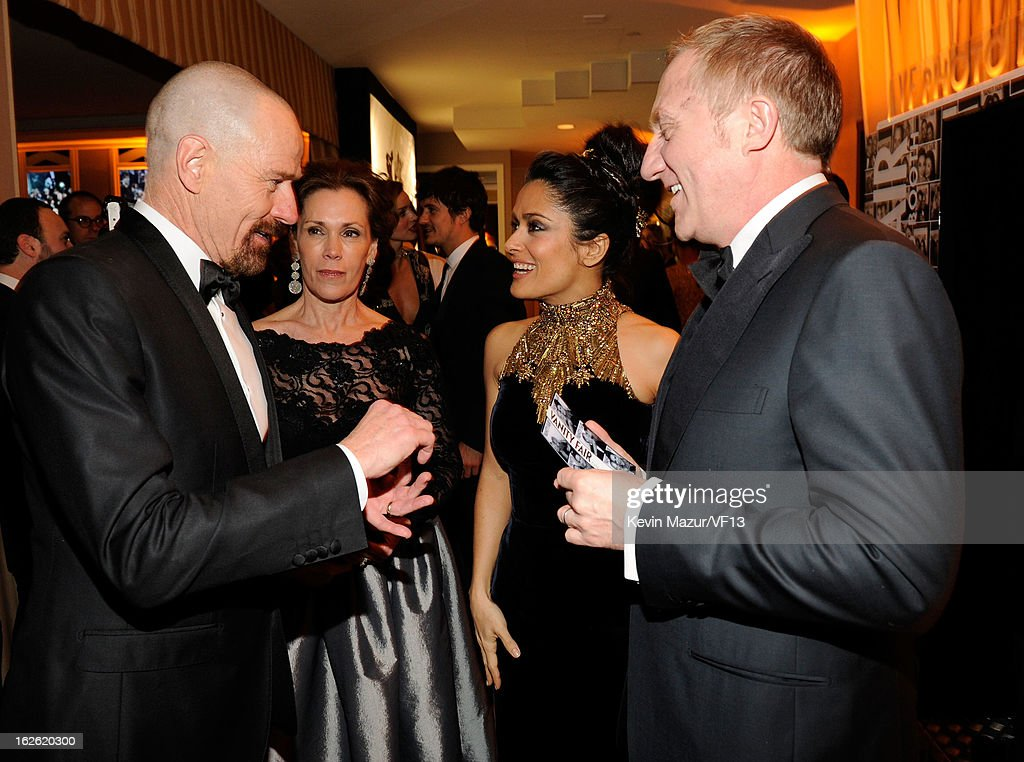 Brian Cranston, Salma Hayek and Francois-Henri Pinault attend the 2013 Vanity Fair Oscar Party hosted by Graydon Carter at Sunset Tower on February 24, 2013 in West Hollywood, California.