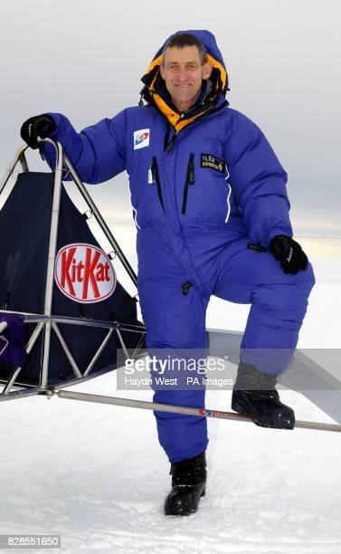 Brian Cunningham aged 59 a Northern Irishman who lives in Bolton standing next to the stateoftheart Kit Kat kitepowered buggy designed by Williams F1...