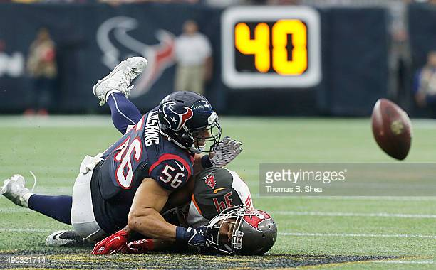 Brian Cushing of the Houston Texans breaks up the pass intended for Charles Sims of the Tampa Bay Buccaneers in the second quarter on September 27...