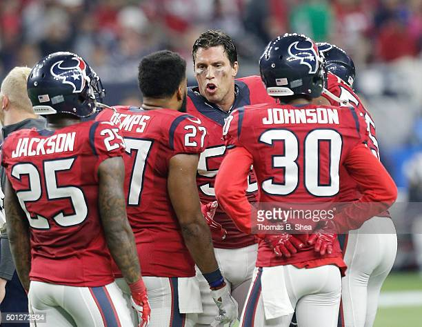Brian Cushing of the Houston Texans talks to the defense during a timeout while playing the New England Patriots in the third quarter on December 13...