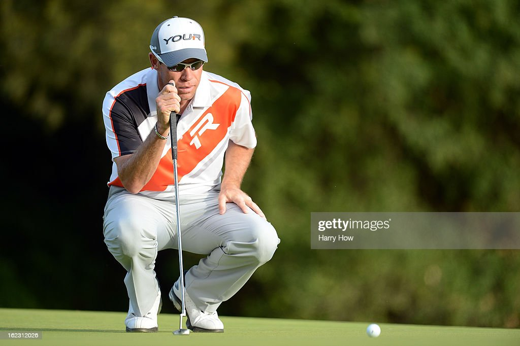 Brian Davis of England lines up his putt on the 12th green during the second round of the Northern Trust Open at the Riviera Country Club on February 15, 2013 in Pacific Palisades, California.