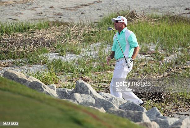 Brian Davis of England plays a shot from the beach on the first playoff hole during the final round of the Verizon Heritage at the Harbour Town Golf...