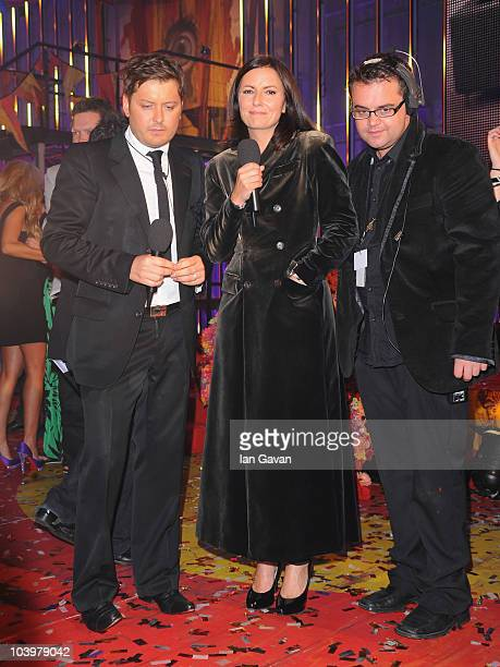 Brian Dowling and Davina McCall watch video monitors during the final of Ultimate Big Brother on September 10 2010 in Borehamwood England