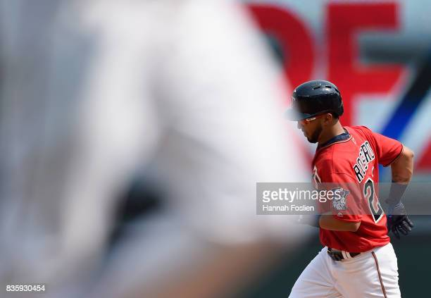 Brian Dozier and Eddie Rosario of the Minnesota Twins round the bases after a grand slam against the Arizona Diamondbacks by Rosario during the first...