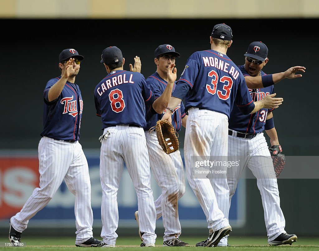 Brian Dozier #2, Jamey Carroll #8, Doug Bernier #17, Justin Morneau #33 and Oswaldo Arcia #31 of the Minnesota Twins celebrate a win of the game against the Houston Astros on August 4, 2013 at Target Field in Minneapolis, Minnesota. The Twins defeated the Astros 3-2.