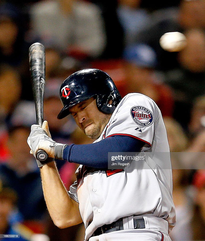 Brian Dozier #2 of the ducks from a pitch in the 9th inning against the Boston Red Soxb at Fenway Park on May 6, 2013 in Boston, Massachusetts.