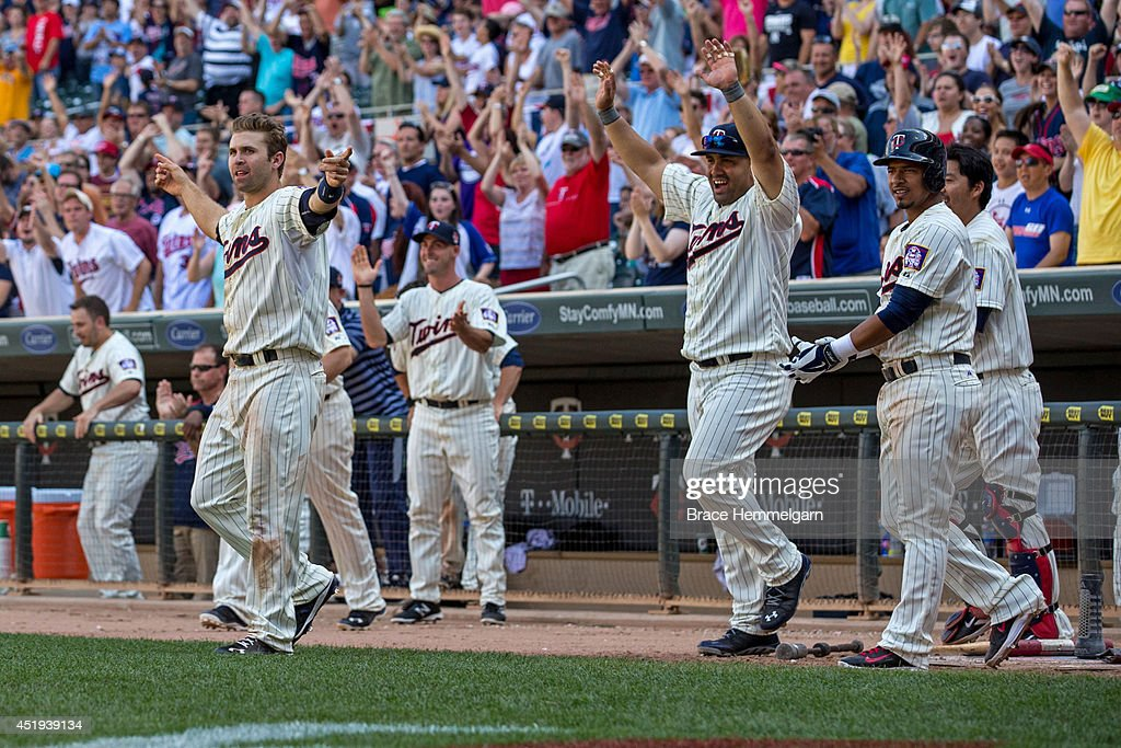 Brian Dozier #2 of the Minnesota Twins and Kendrys Morales #17 celebrate a walk-off win against the New York Yankees on July 5, 2014 at Target Field in Minneapolis, Minnesota. The Twins defeated the Yankees 2-1.