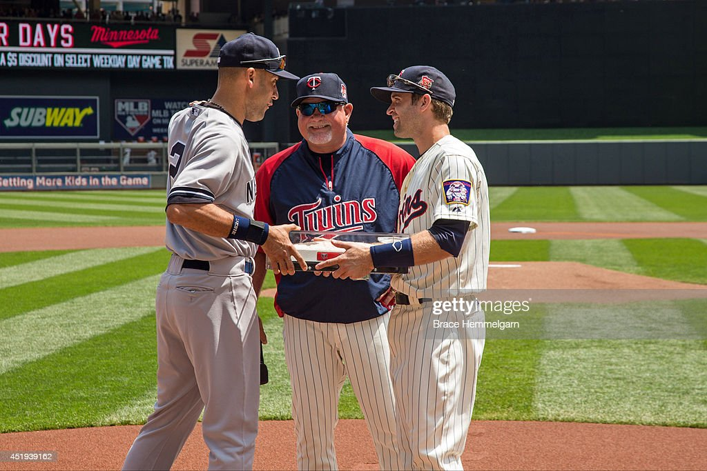 <a gi-track='captionPersonalityLinkClicked' href=/galleries/search?phrase=Brian+Dozier&family=editorial&specificpeople=7553002 ng-click='$event.stopPropagation()'>Brian Dozier</a> #2 of the Minnesota Twins and <a gi-track='captionPersonalityLinkClicked' href=/galleries/search?phrase=Ron+Gardenhire&family=editorial&specificpeople=220870 ng-click='$event.stopPropagation()'>Ron Gardenhire</a> #35 present <a gi-track='captionPersonalityLinkClicked' href=/galleries/search?phrase=Derek+Jeter&family=editorial&specificpeople=167125 ng-click='$event.stopPropagation()'>Derek Jeter</a> #2 of the New York Yankees the final second base from the Metrodome prior to the game on July 5, 2014 at Target Field in Minneapolis, Minnesota. The Twins defeated the Yankees 2-1.