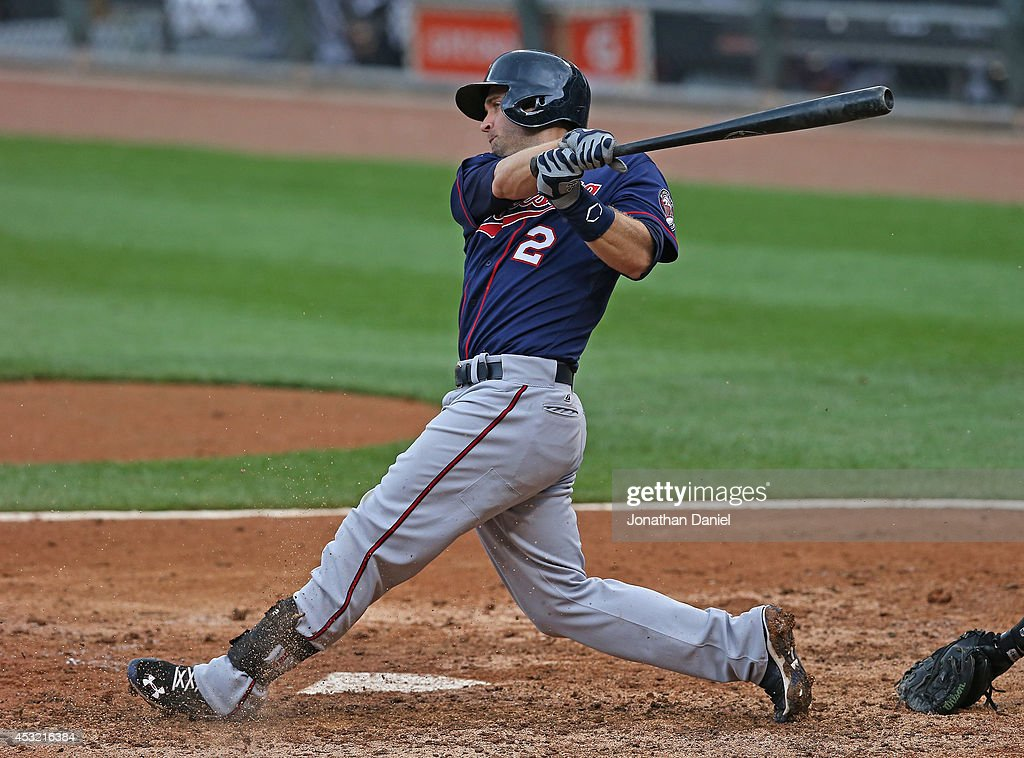 Brian Dozier #2 of the Minnesota Twins bats against the Chicago White Sox at U.S. Cellular Field on August 3, 2014 in Chicago, Illinois. The Twins defeated the White Sox 16-3.