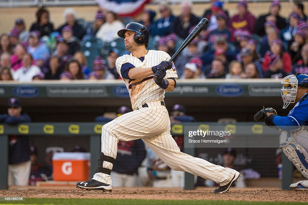 Brian Dozier of the Minnesota Twins bats against the Kansas City Royals on October 3 2015 at Target Field in Minneapolis Minnesota The Royals...