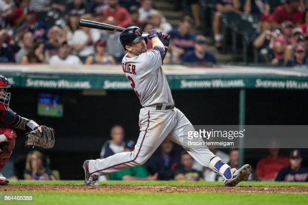 Brian Dozier of the Minnesota Twins bats and hits a home run against the Cleveland Indians on September 26 2017 at Progressive Field in Cleveland...