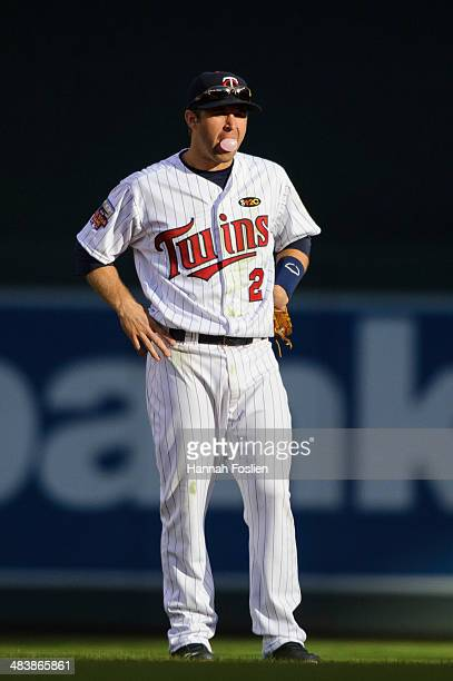 Brian Dozier of the Minnesota Twins blows a bubble while playing second base during the game against the Oakland Athletics on April 7 2014 at Target...