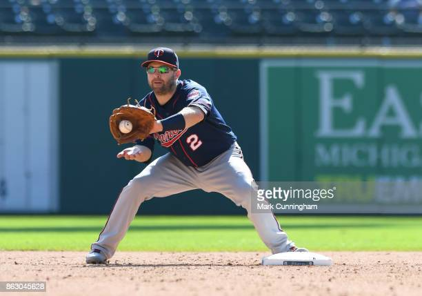 Brian Dozier of the Minnesota Twins catches a baseball during the game against the Detroit Tigers at Comerica Park on September 24 2017 in Detroit...