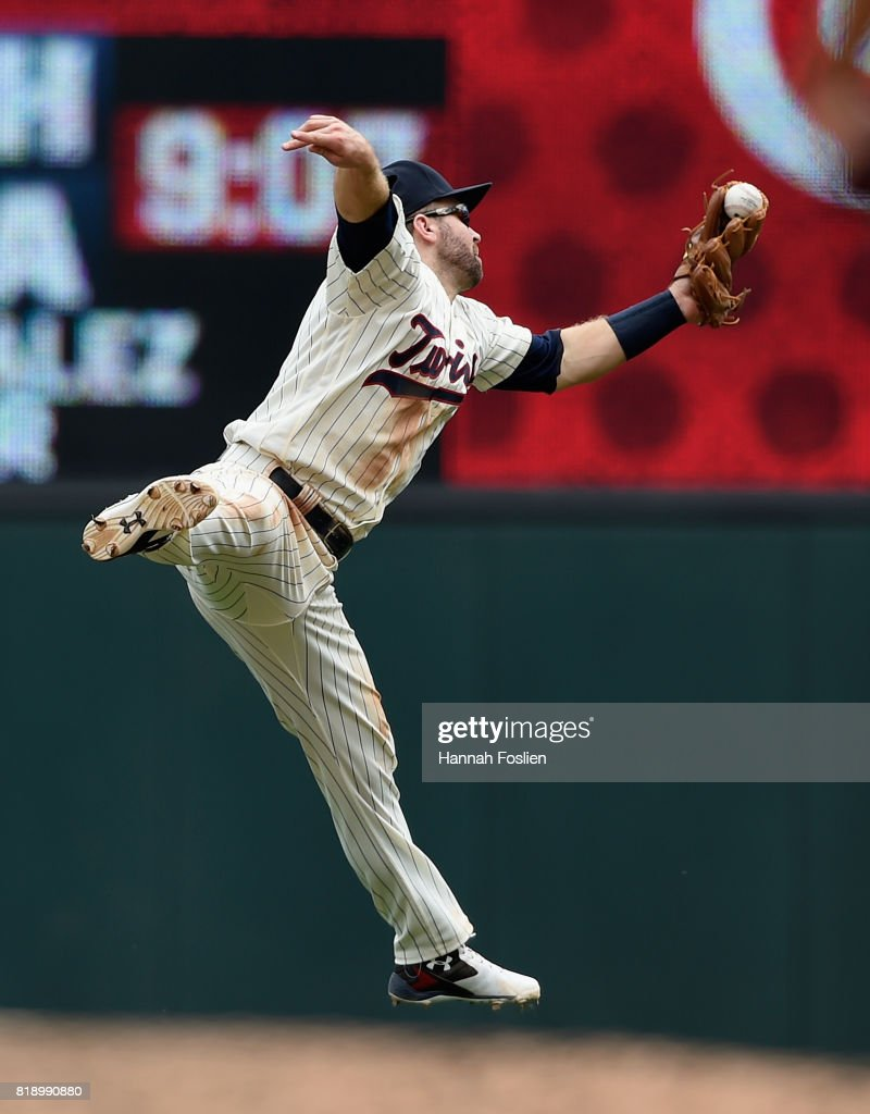 Brian Dozier #2 of the Minnesota Twins catches the ball hit by Austin Romine #27 of the New York Yankees during the fifth inning of the game on July 19, 2017 at Target Field in Minneapolis, Minnesota. The Twins defeated the Yankees 6-1.