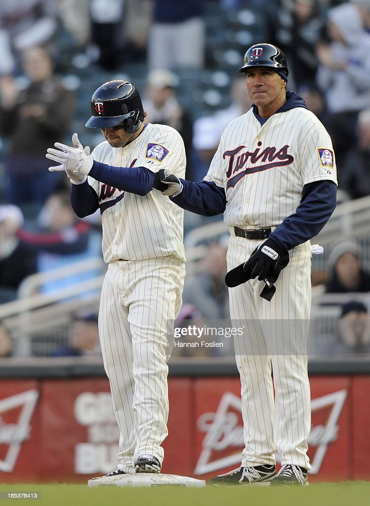 <a gi-track='captionPersonalityLinkClicked' href=/galleries/search?phrase=Brian+Dozier&family=editorial&specificpeople=7553002 ng-click='$event.stopPropagation()'>Brian Dozier</a> #2 of the Minnesota Twins celebrates a double in the ninth inning with first base coach Scott Ullger #45 against the Detroit Tigers on April 3, 2013 at Target Field in Minneapolis, Minnesota. The Twins defeated the Tigers 3-2.