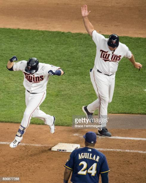 Brian Dozier of the Minnesota Twins celebrates a home run against the Milwaukee Brewers on August 8 2017 at Target Field in Minneapolis Minnesota The...