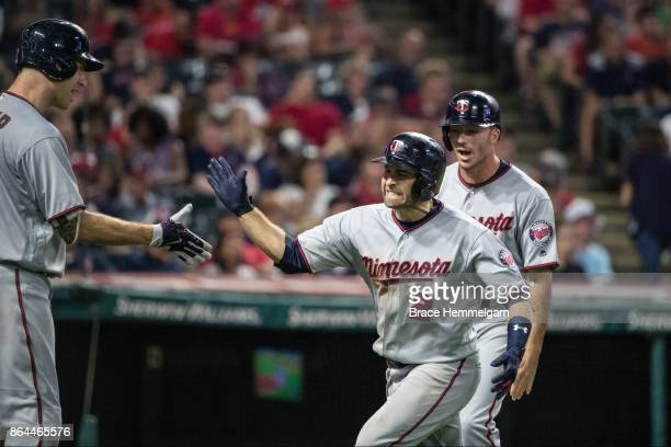 Brian Dozier of the Minnesota Twins celebrates a home run against the Cleveland Indians on September 26 2017 at Progressive Field in Cleveland Ohio...