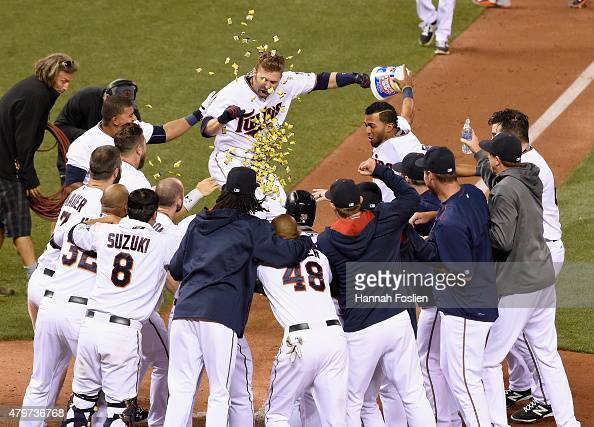 Brian Dozier of the Minnesota Twins celebrates a walkoff tworun home run against the Baltimore Orioles in the tenth inning of the game on July 6 2015...