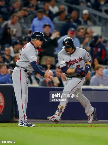 Brian Dozier of the Minnesota Twins celebrates his first inning home run against the New York Yankees in the American League Wild Card Game with...