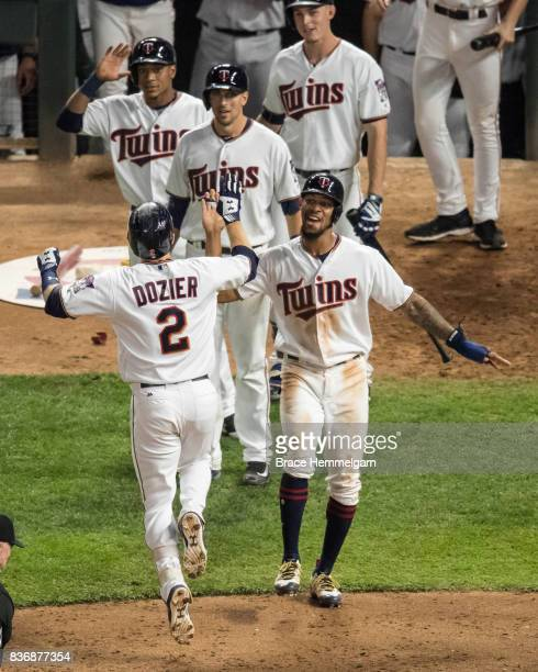 Brian Dozier of the Minnesota Twins celebrates his home run with Byron Buxton against the Milwaukee Brewers on August 8 2017 at Target Field in...