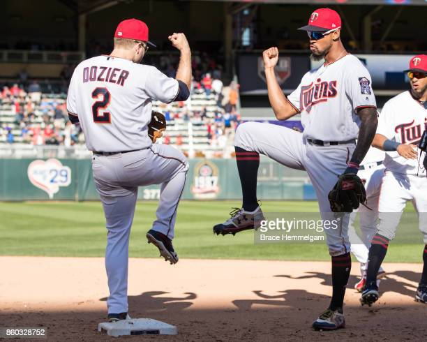 Brian Dozier of the Minnesota Twins celebrates with Byron Buxton against the Toronto Blue Jays on September 17 2017 at Target Field in Minneapolis...