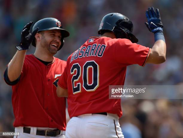 Brian Dozier of the Minnesota Twins congratulates teammate Eddie Rosario on grand slam against the Arizona Diamondbacks during the first inning of...