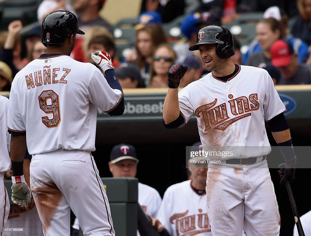 Brian Dozier #2 of the Minnesota Twins congratulates teammate Eduardo Nunez #9 on scoring a run against the Boston Red Sox during the second inning of the game on May 25, 2015 at Target Field in Minneapolis, Minnesota. The Twins defeated the Red Sox 7-2.