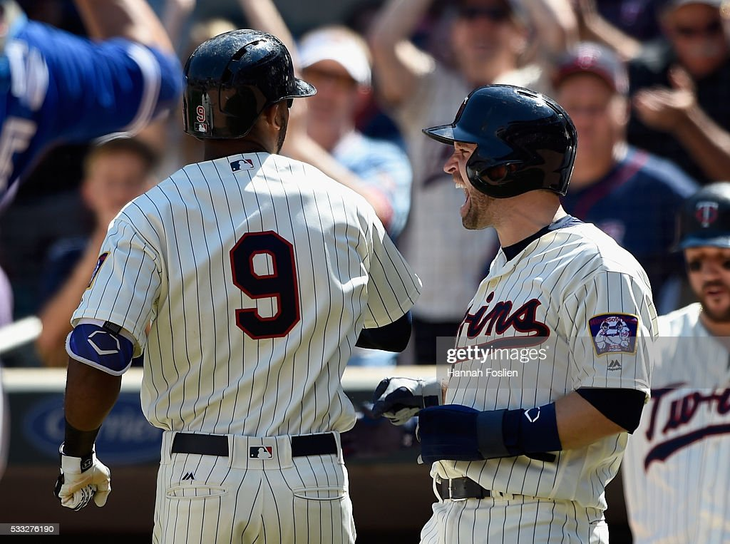 <a gi-track='captionPersonalityLinkClicked' href=/galleries/search?phrase=Brian+Dozier&family=editorial&specificpeople=7553002 ng-click='$event.stopPropagation()'>Brian Dozier</a> #2 of the Minnesota Twins congratulates teammate <a gi-track='captionPersonalityLinkClicked' href=/galleries/search?phrase=Eduardo+Nunez&family=editorial&specificpeople=4900197 ng-click='$event.stopPropagation()'>Eduardo Nunez</a> #9 on a three-run home run against the Toronto Blue Jays during the eighth inning of the game on May 21, 2016 at Target Field in Minneapolis, Minnesota. The Twins defeated the Blue Jays 5-3.