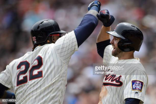 Brian Dozier of the Minnesota Twins congratulates teammate Miguel Sano a threerun home run against the New York Yankees during the game on July 19...