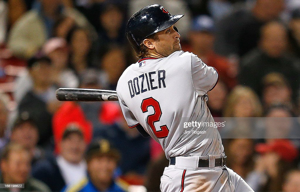 Brian Dozier #2 of the Minnesota Twins connects for a game-tying home run in the 9th inning against the Boston Red Soxb at Fenway Park on May 6, 2013 in Boston, Massachusetts.