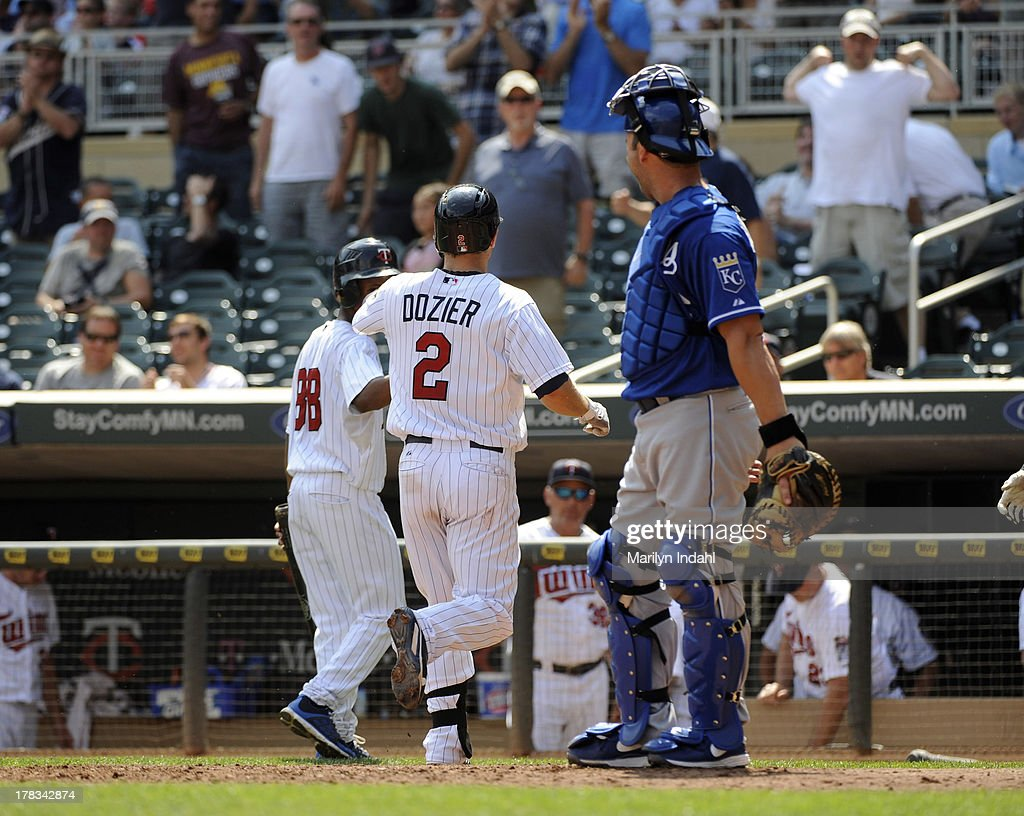 <a gi-track='captionPersonalityLinkClicked' href=/galleries/search?phrase=Brian+Dozier&family=editorial&specificpeople=7553002 ng-click='$event.stopPropagation()'>Brian Dozier</a> #2 of the Minnesota Twins crosses the plate a home run in the sixth inning against the Kansas City Royals at Target Field on August 29, 2013 in Minneapolis, Minnesota.