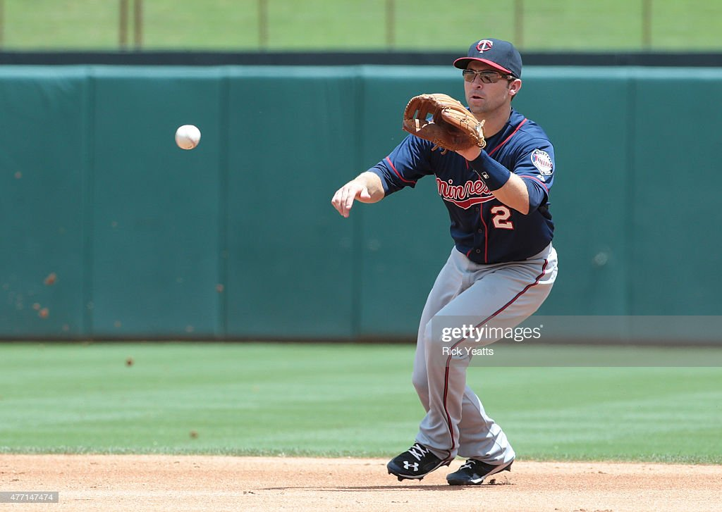Brian Dozier of the Minnesota Twins fields a ground ball against Mitch Moreland of the Texas RangersTexas at Global Life Park in Arlington on June 14...