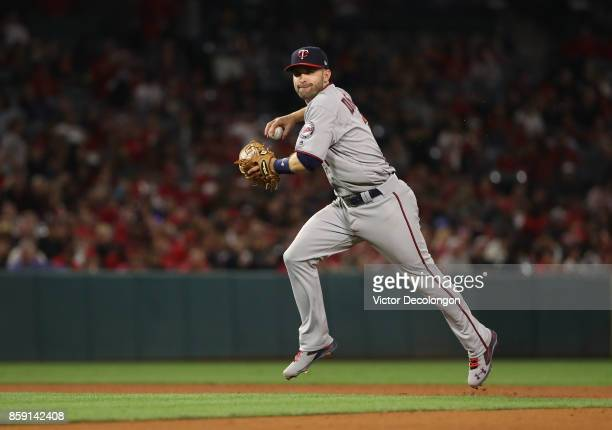 Brian Dozier of the Minnesota Twins fields a throw to first base in the fifth inning during the MLB game against the Los Angeles Angels of Anaheim at...
