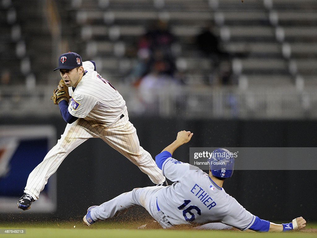 <a gi-track='captionPersonalityLinkClicked' href=/galleries/search?phrase=Brian+Dozier&family=editorial&specificpeople=7553002 ng-click='$event.stopPropagation()'>Brian Dozier</a> #2 of the Minnesota Twins gets the force out of <a gi-track='captionPersonalityLinkClicked' href=/galleries/search?phrase=Andre+Ethier&family=editorial&specificpeople=543213 ng-click='$event.stopPropagation()'>Andre Ethier</a> #16 of the Los Angeles Dodgers at second base during the ninth inning of the game on April 30, 2014 at Target Field in Minneapolis, Minnesota. The Dodgers defeated the Twins 6-4.