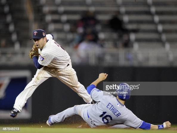 Brian Dozier of the Minnesota Twins gets the force out of Andre Ethier of the Los Angeles Dodgers at second base during the ninth inning of the game...