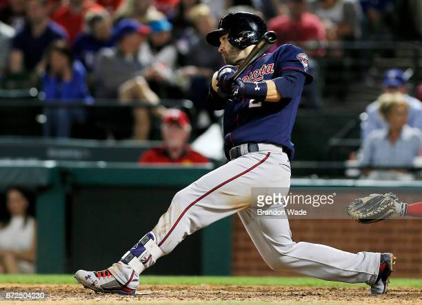 Brian Dozier of the Minnesota Twins hits a threerun double during the fifth inning of a baseball game against the Texas Rangers at Globe Life Park on...