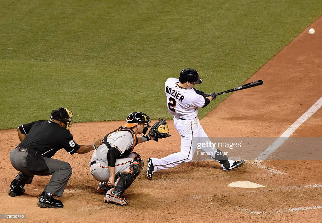 Brian Dozier of the Minnesota Twins hits a walkoff tworun home run as Matt Wieters of the Baltimore Orioles catches during the tenth inning of the...