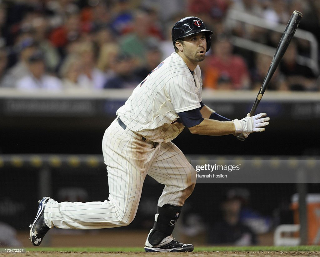 Brian Dozier #2 of the Minnesota Twins hits an RBI double against the Houston Astros during the seventh inning of the game on August 3, 2013 at Target Field in Minneapolis, Minnesota. The Twins defeated the Astros 6-4.