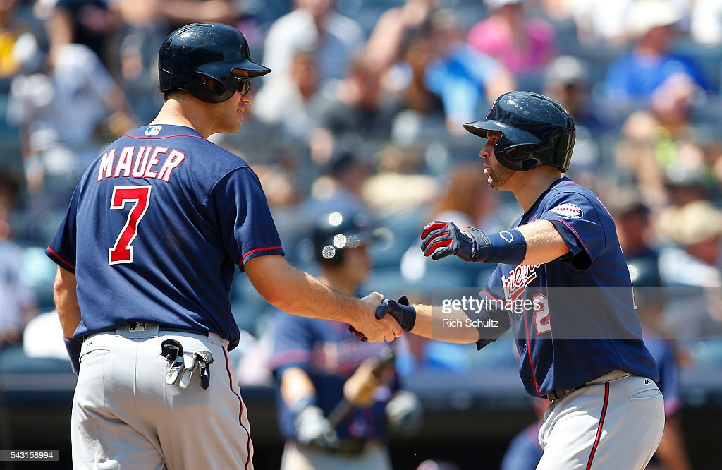 <a gi-track='captionPersonalityLinkClicked' href=/galleries/search?phrase=Brian+Dozier&family=editorial&specificpeople=7553002 ng-click='$event.stopPropagation()'>Brian Dozier</a> #2 of the Minnesota Twins is congratulated by <a gi-track='captionPersonalityLinkClicked' href=/galleries/search?phrase=Joe+Mauer&family=editorial&specificpeople=214614 ng-click='$event.stopPropagation()'>Joe Mauer</a> #7 after they scored on Dozier's two run home run in the sixth inning against the New York Yankees during a game at Yankee Stadium on June 26, 2016 in the Bronx borough of New York City.