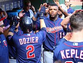 Brian Dozier of the Minnesota Twins is congratulated by Kennys Vargas for hitting a solo home run in the seventh inning against the Texas Rangers at...