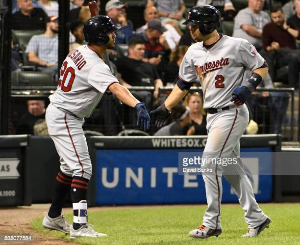Brian Dozier of the Minnesota Twins is greeted by Eddie Rosario after scoring against the Chicago White Sox during the sixth inning on August 23 2017...