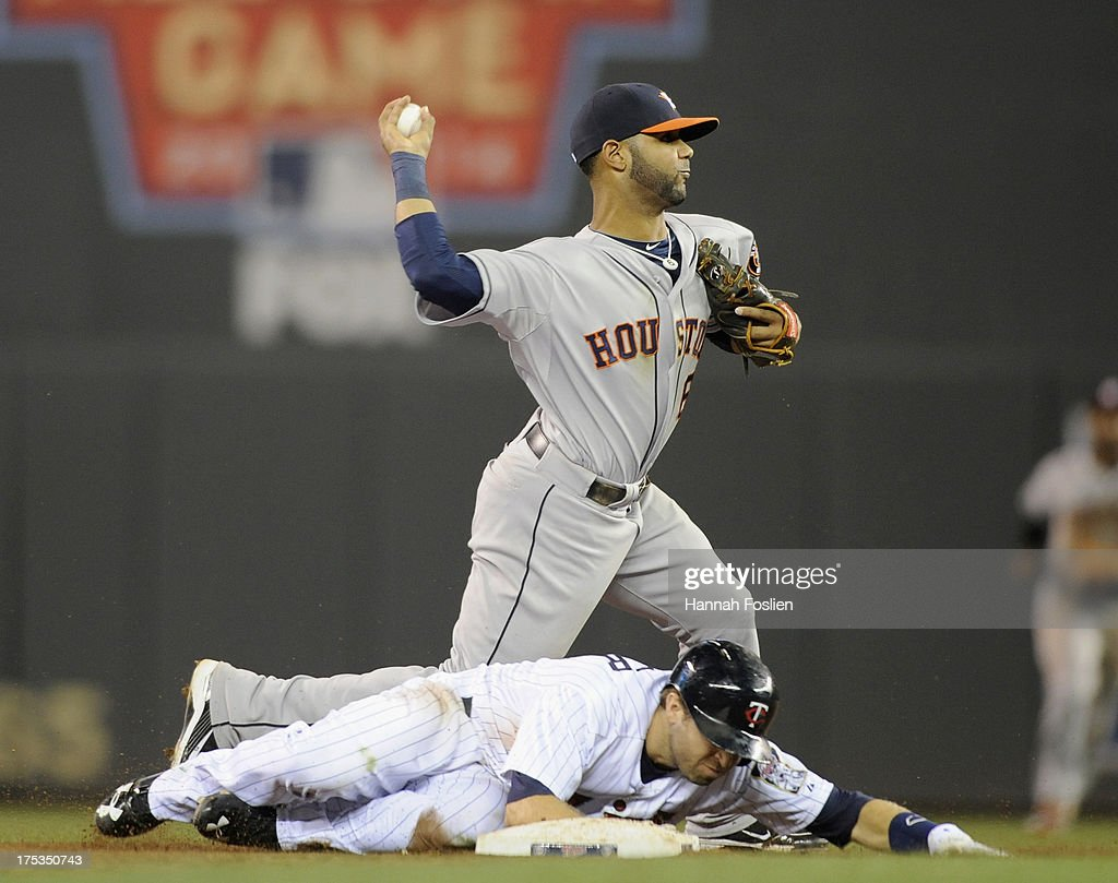 Brian Dozier #2 of the Minnesota Twins is out at second base as Jonathan Villar #6 of the Houston Astros attempts to turn a double play during the ninth inning of the game on August 2, 2013 at Target Field in Minneapolis, Minnesota. The Twins defeated the Astros 4-3 in thirteen inning.