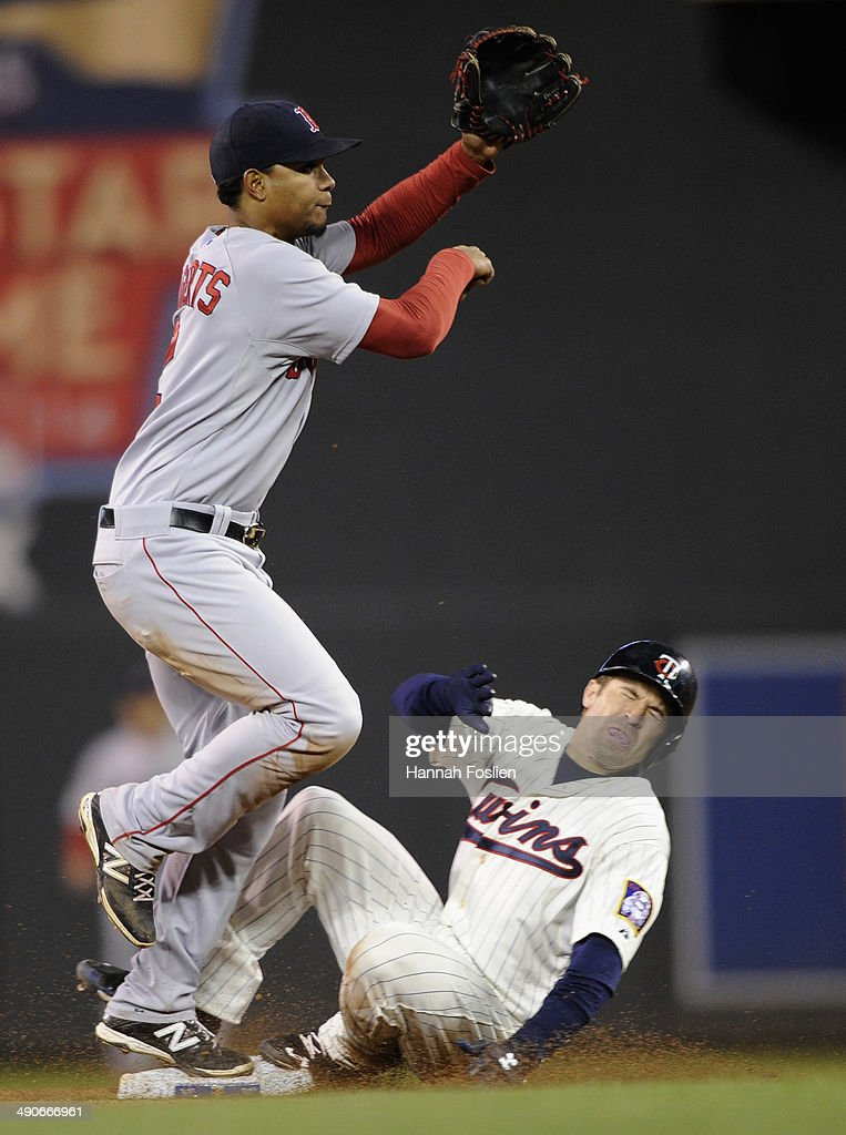 Brian Dozier of the Minnesota Twins is out at second base as Xander Bogaerts of the Boston Red Sox turns a double play seventh inning of the game on...