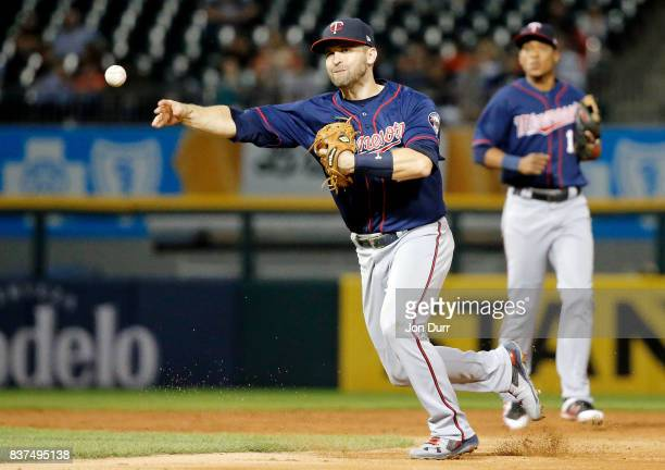Brian Dozier of the Minnesota Twins late on the throw to first base on a single hit by Jose Abreu of the Chicago White Sox during the third inning at...