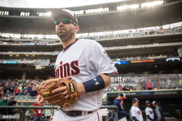 Brian Dozier of the Minnesota Twins looks on against the Detroit Tigers on October 1 2017 at Target Field in Minneapolis Minnesota The Twins defeated...