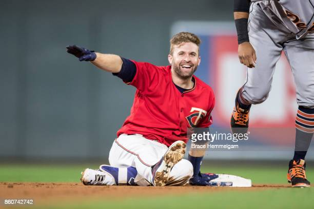 Brian Dozier of the Minnesota Twins looks on and celebrates against the Detroit Tigers on September 29 2017 at Target Field in Minneapolis Minnesota...